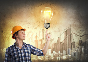 worker-pointing-to-bulb-with-building-background