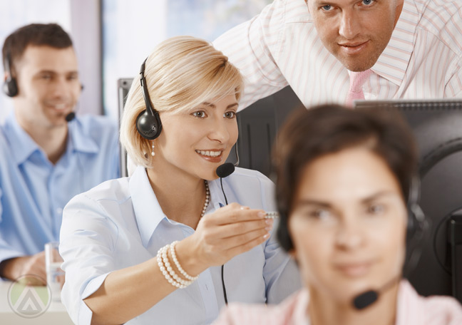 call-center-manager-and-agent-listening-to-recorded-calls--Open-Access-BPO--