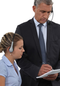 call-center-manager-and-agent-listening-to-recorded-calls--Open-Access-BPO---