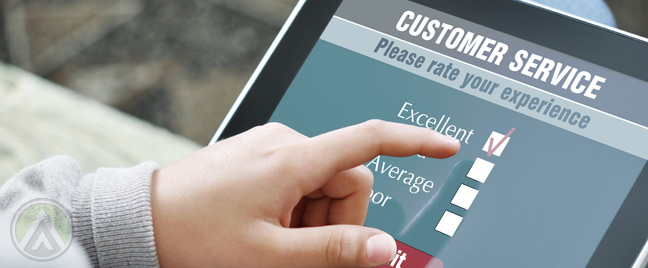man-answering-customer-service-survey-on-tablet