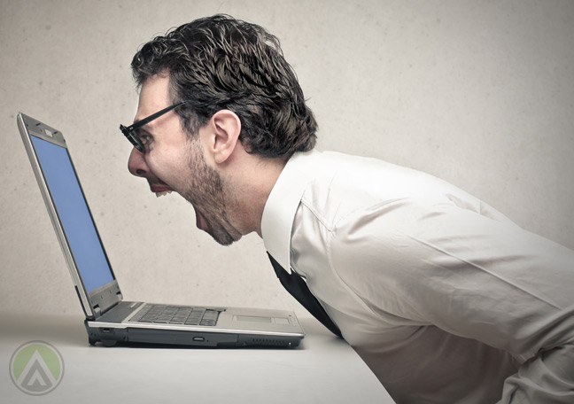 male-agent-screaming-on-laptop