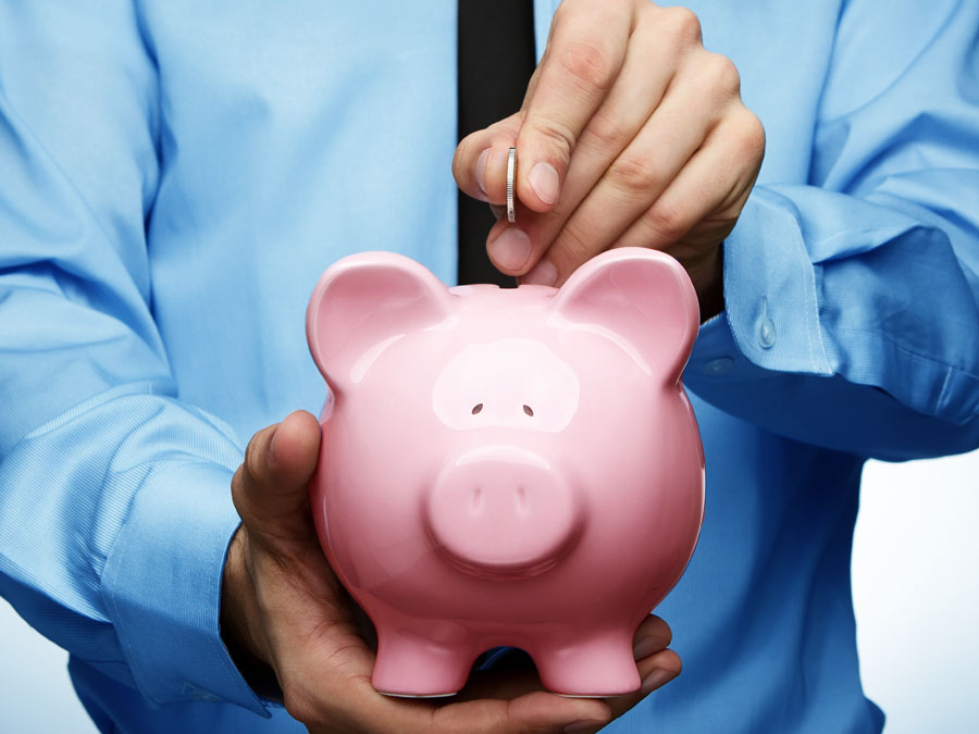 businessman saving money on piggybank