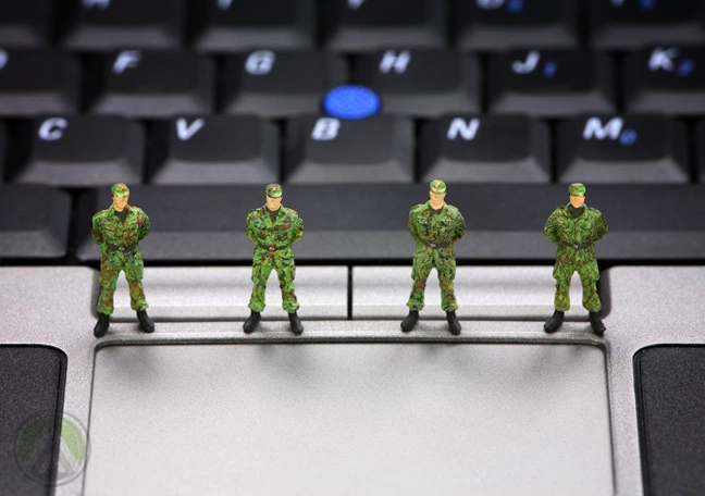 tiny-toy-soldiers-standing-on-laptop-keyboard-trackpad