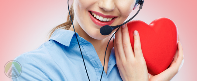 smiling female call center agent holding giant heart