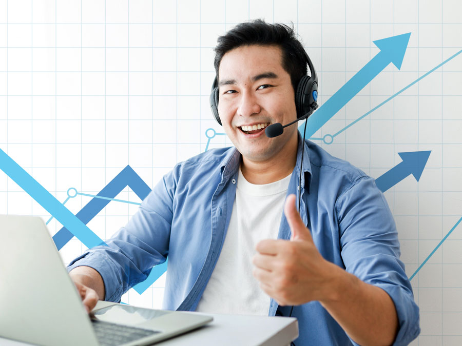 Japanese call center agent giving thumbs up with successful chart background
