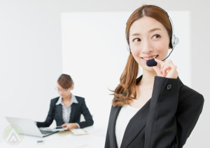 female-chinese-call-center-agent-boss-on-background