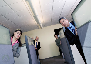 call-center-agents-peeking-at-their-work-stations