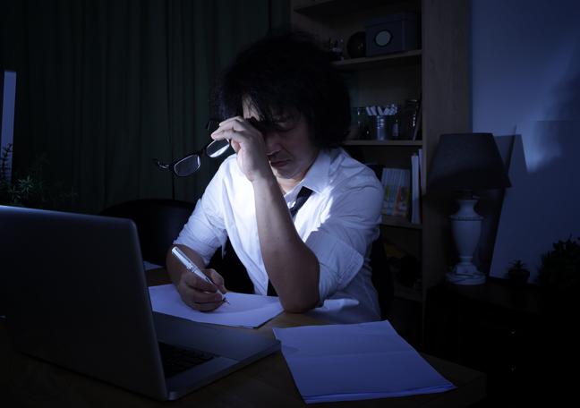 workaholic japanese businessman working in dark office