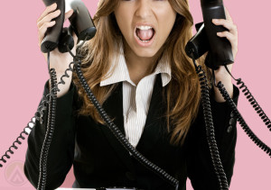 female-call-center-agent-holding-six-telephones
