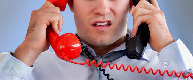 male-agent-holding-two-telephones