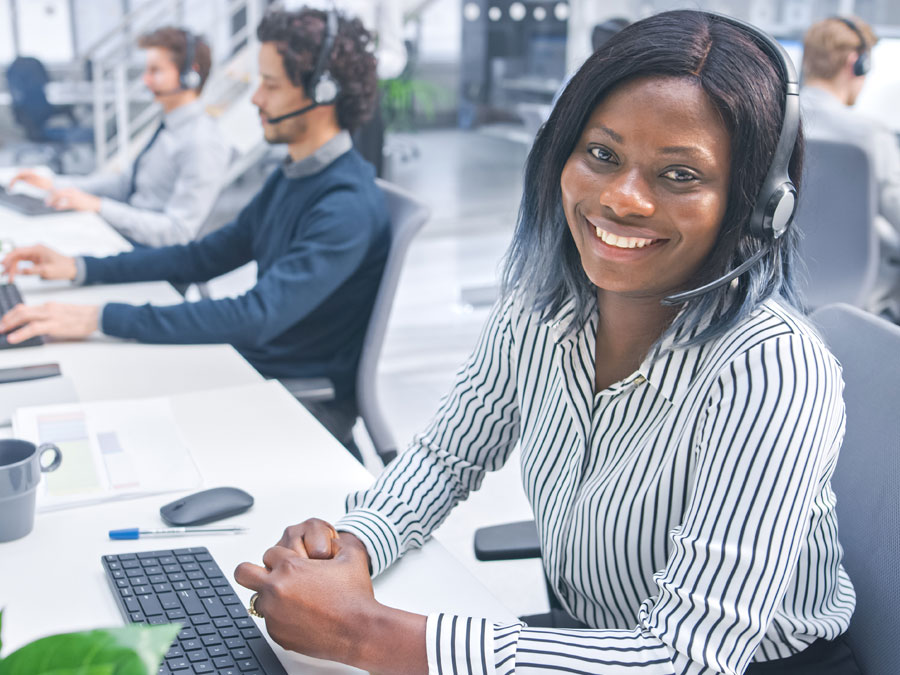 smiling customer support agent working in call center