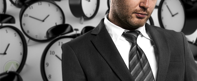 male-businessman-with-clocks-background