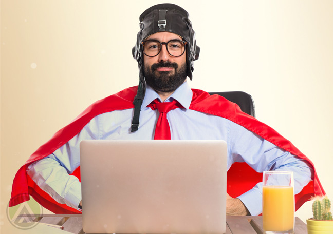 bearded-employee-in-glasses-wearing-superhero-costumer-cape-at-work