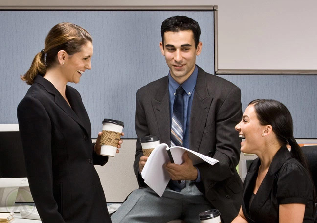 office-coworkers-having-a-lively-chat-over-coffee