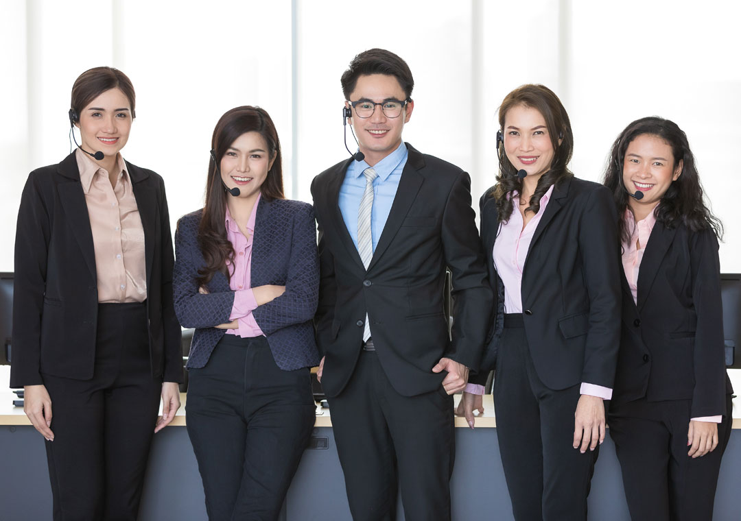 smiling Asian outsourcing call center business team
