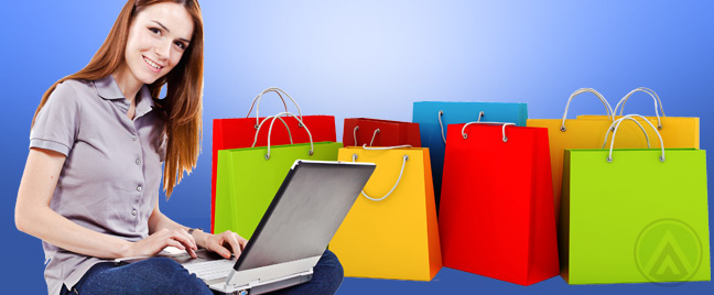 female-with-laptop-and-shopping-bags