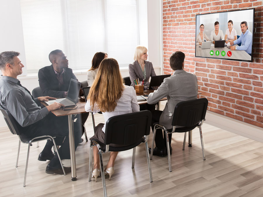 managers in teleconference with call center in the Philippines