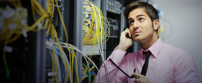 technical support staff in server room thinking using phone
