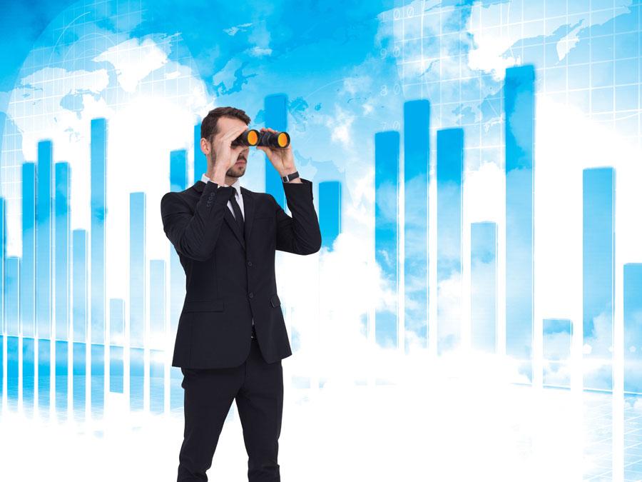 businessman looking through binocular