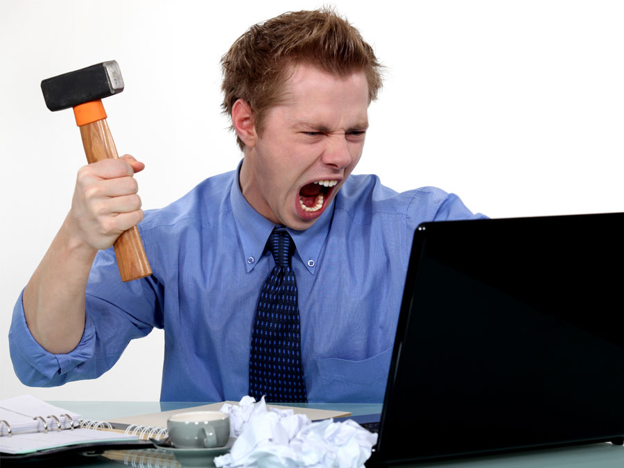 customer service outsourcing agent angry with laptop