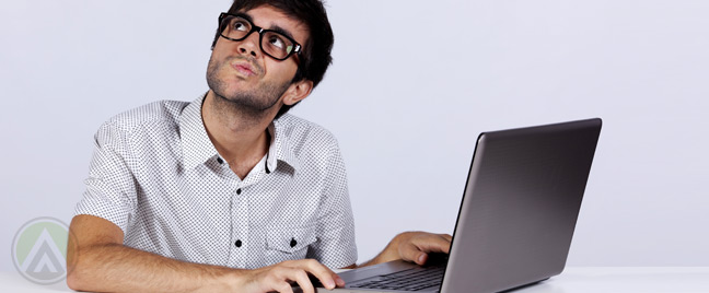 thinking-male-image-moderator-in-front-of-laptop