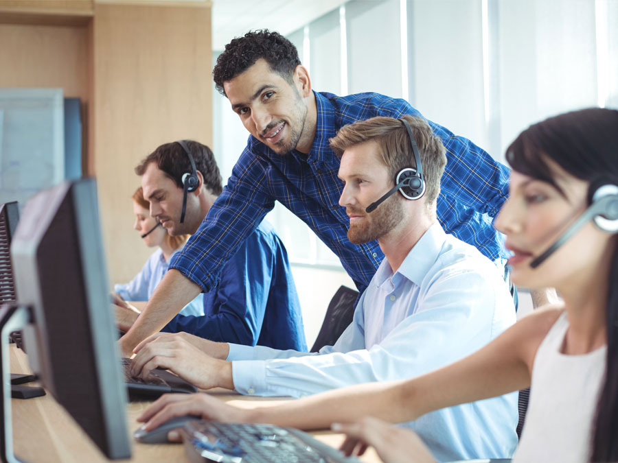 call center team leader helping customer support agent