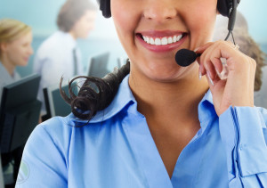 smiling-female-outbound-call-center-agent-team-at-the-back