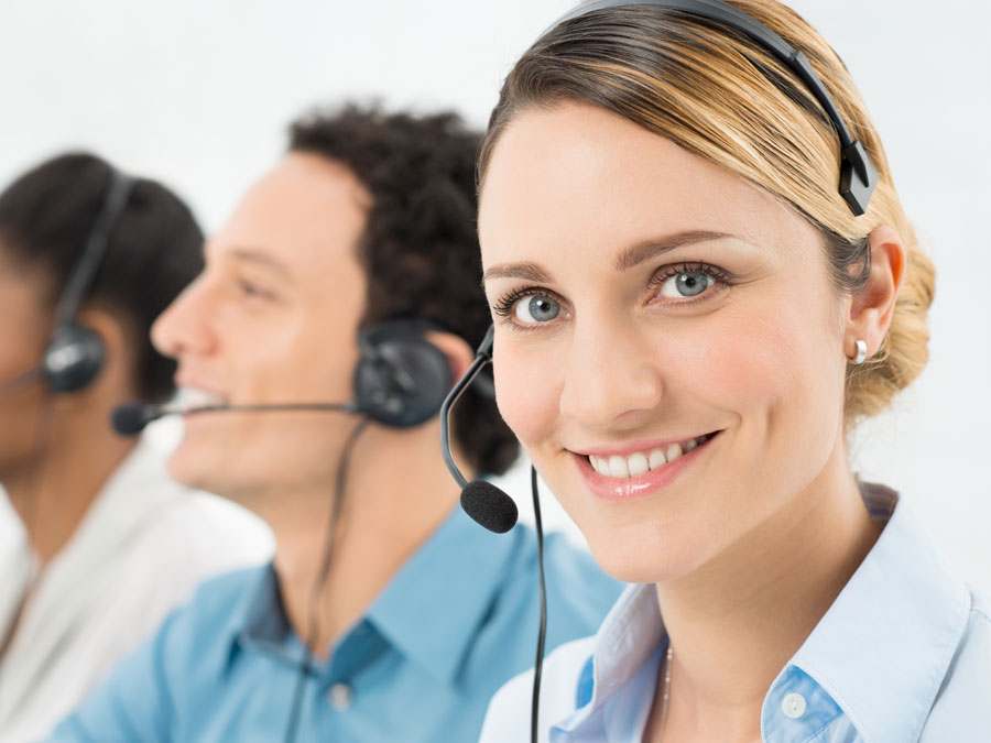 smiling mulitlingual call center agent with technical support team