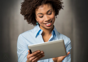 smiling-female-call-center-agent-holding-a-tablet