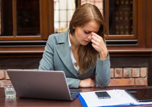 female-regretting-business-mistake-female-executive