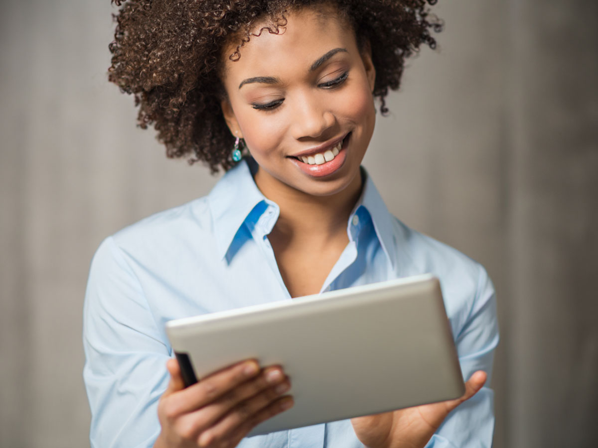 woman using tablet to access customer service