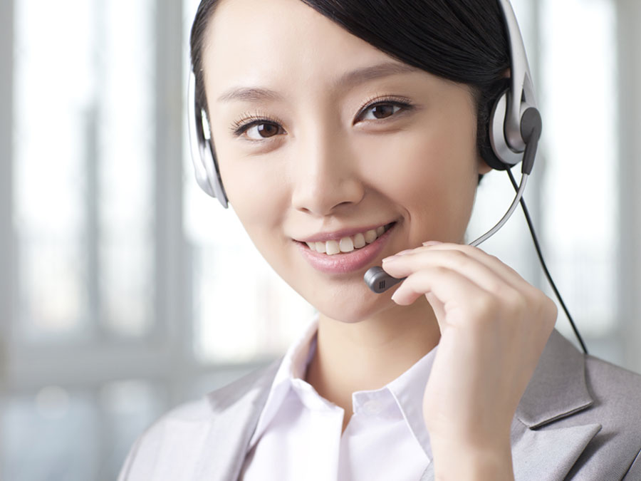 smiling call center agent talking to customer
