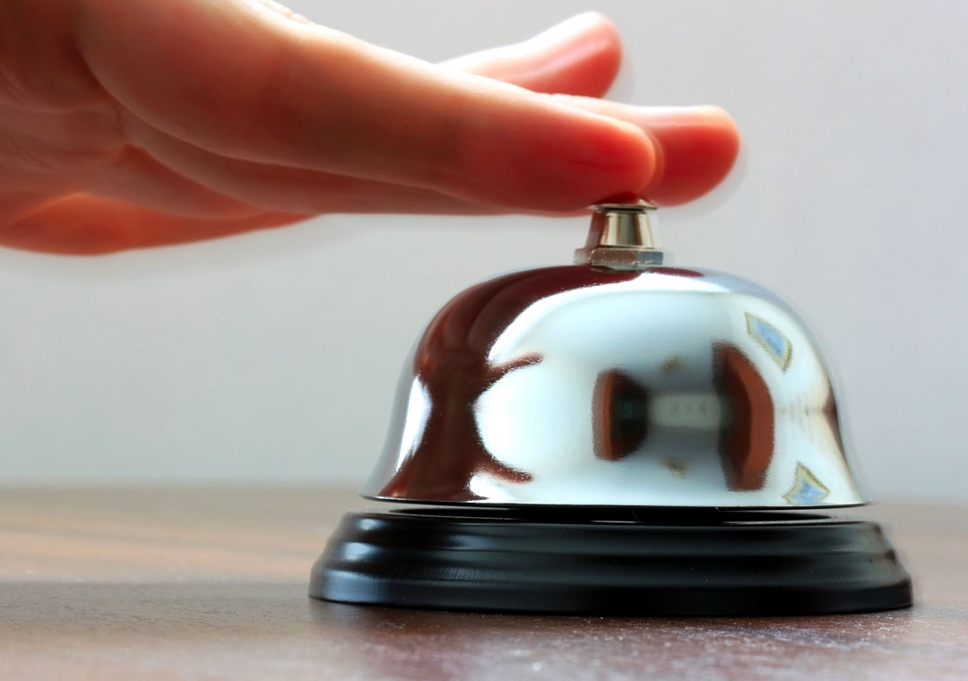 live chat depiction close up hands pushing service bell