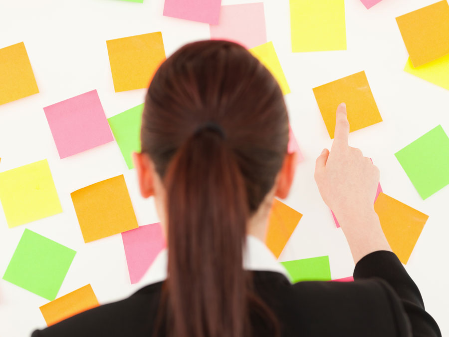 content moderation analyst pointing at post it notes
