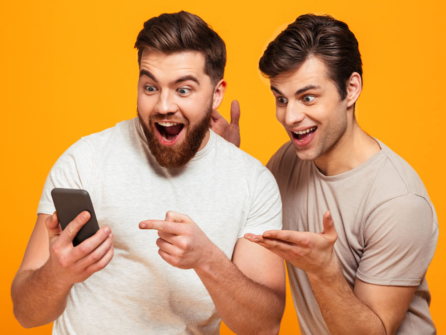 impressed delighted customers pointing at smartphone