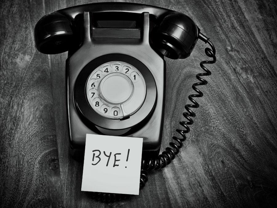 landline telephone with post it written Bye