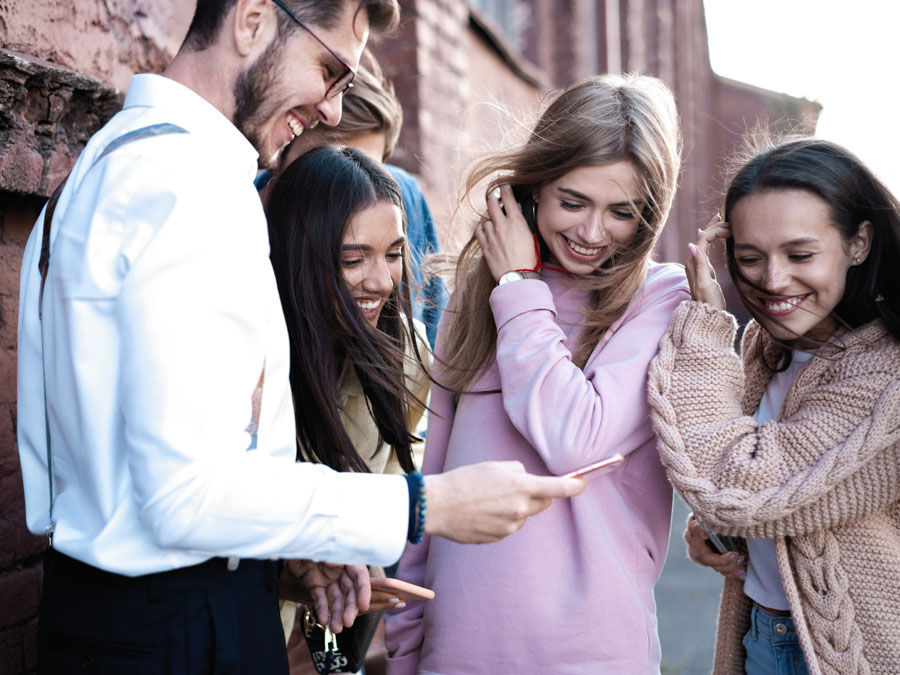 millennials happily looking at smartphone