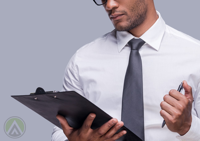 businessman-holding-pen-and-clipboard