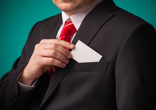 businessman-pulling-business-card