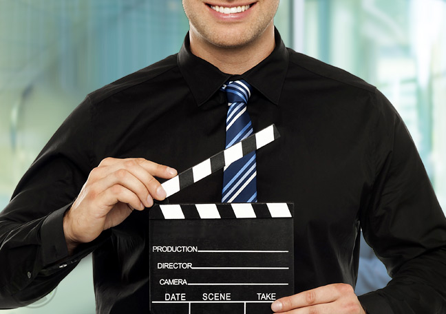 businessman-with-video-cinema-clapper