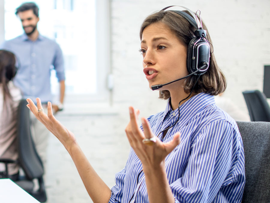 customer service agent busy talking to customer in call center with hand gestures