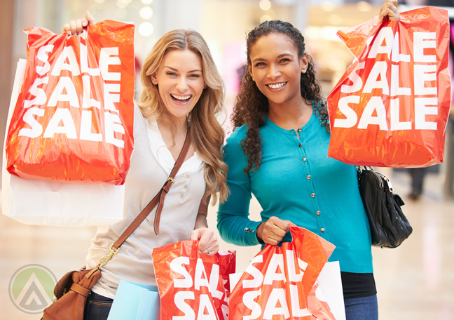 female-bargain-hunters-with-sale-shopping-bags