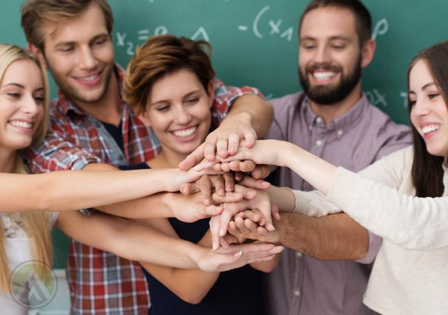 group-millennials-stacking-hands