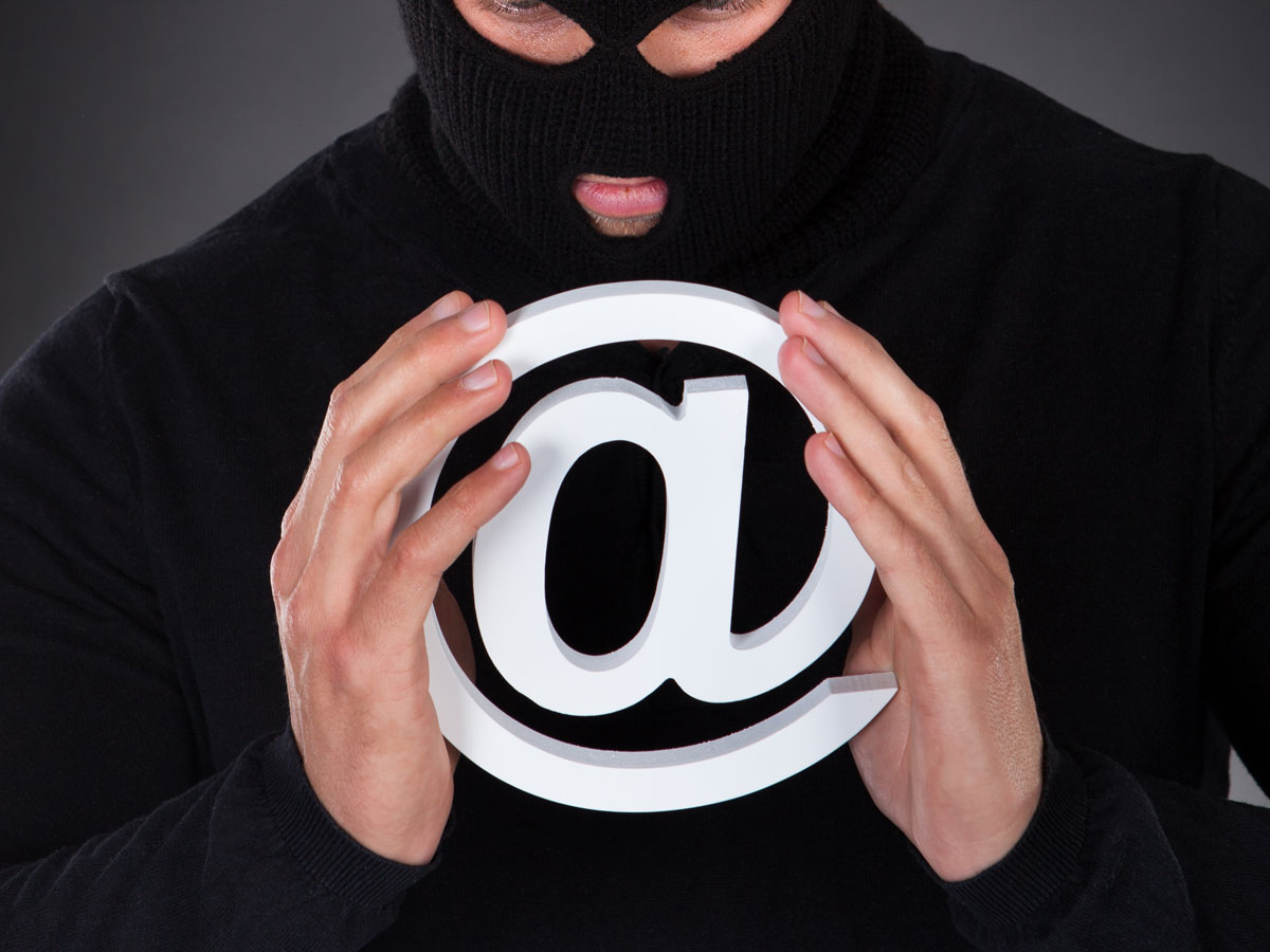 social engineer in ski mask holding email