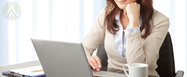 businesswoman-working-in-office-on-laptop