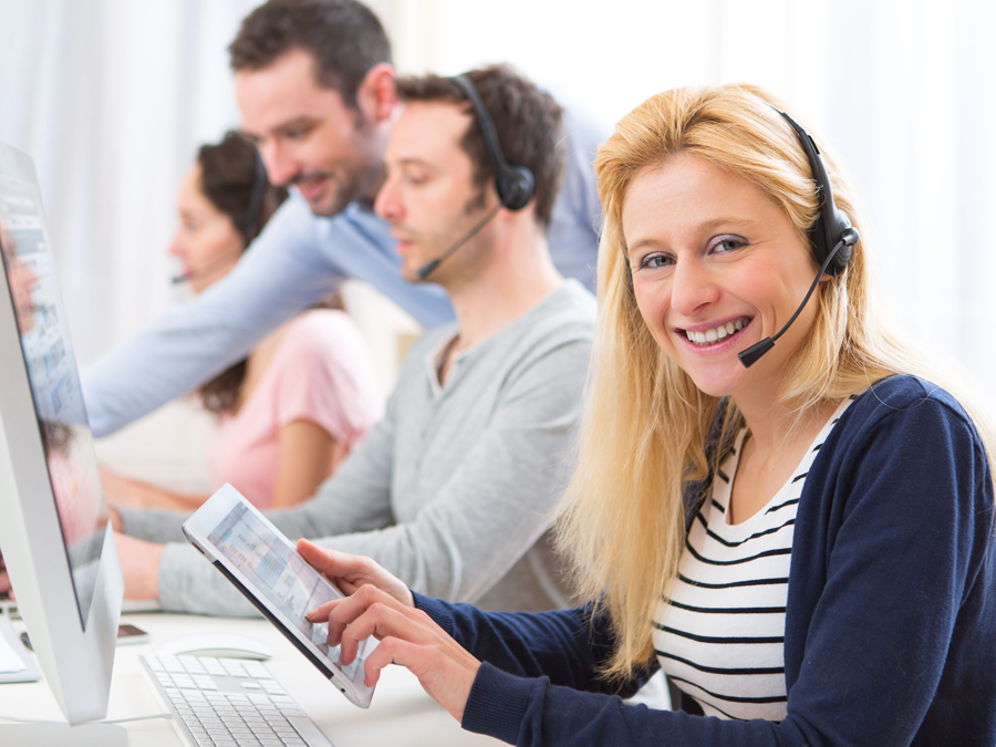 smiling call center agent using tablet