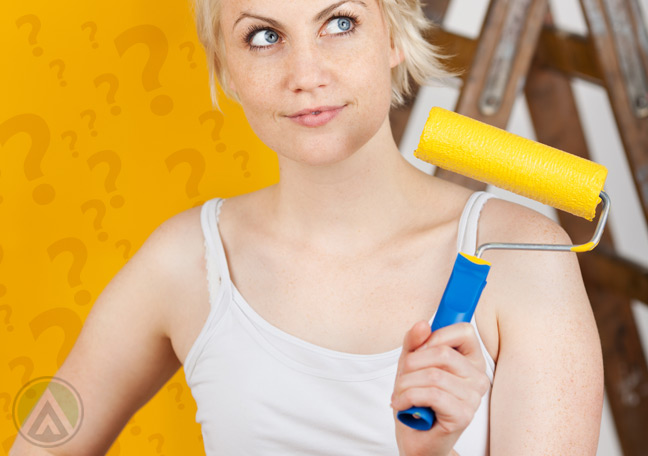 female-painter-with-yellow-paint-anfemale-painter-with-yellow-paint-and-question-markd-question-mark