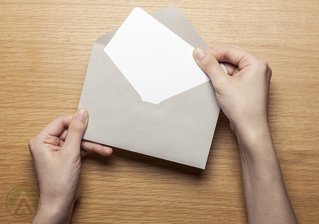 hands-taking-out-paper-from-envelope