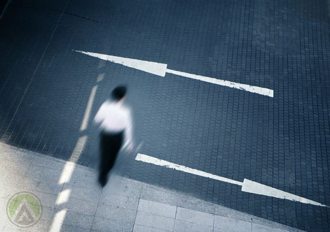 male-business-executive-in-white-crossing-the-street