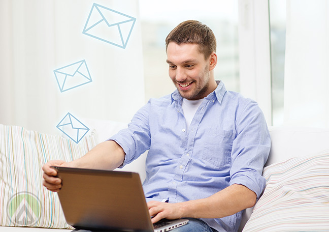 man-with-laptop-satisfied-with-emails